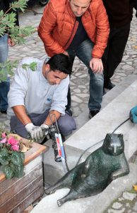 "ISTANBUL, TURKEY - NOVEMBER 12 : Kadikoy municipality worker siliconizes the ""Tombili"" which means ""cute and chubby"" statue after stolen and has been found in Istanbul, Turkey on November 12, 2016.Social media phenomenon ""Tombili"" the Cat had been passed away several months ago. Istanbul's Kadikoy municipality had agreed to erect a statue of her after receiving over 16,000 signatures in an online petition. Metin Tokgoz / Anadolu Agency"