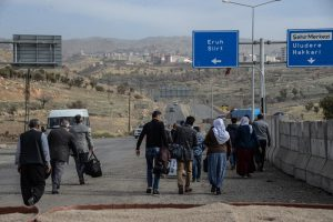 People walk toward Sirnak city on November 14, 2016, after a 246-day curfew was partially lifted. / AFP PHOTO / ILYAS AKENGIN
