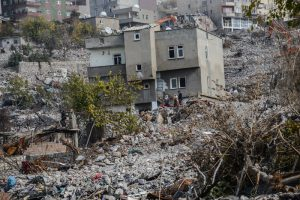 Damaged buildings are seen in Sirnak city on November 14, 2016, after a 246-day curfew was partially lifted. / AFP PHOTO / ILYAS AKENGIN