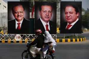 ISLAMABAD, PAKISTAN - NOVEMBER 16: Posters illustrating the images of Turkish President Recep Tayyip Erdogan (C) ,Pakistani President Mamnoon Hussain (L) and Prime Minister Nawaz Sharif (R) are seen on the poles on the main highway prior to the arrival of the Turkish President Recep Tayyip Erdogan in Islamabad, Pakistan, on November 16, 2016.