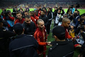 ISTANBUL, TURKEY - DECEMBER: Players and referees give carnations to police officers to pay tribute for police officers, who were martyred on Istanbul terror attacks near the Vodofone Arena yestarday, during the Turkish Spor Toto Super Lig football match between Galatasaray and Gaziantepspor at TT Arena in Istanbul, Turkey on December 11, 2016. Abdullah Coskun / Anadolu Agency