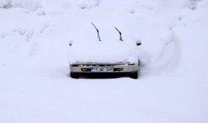 BITLIS, TURKEY - DECEMBER 26: A car covered with snow is seen during heavy winter conditions in Bitlis province of Turkey on December 26, 2016. Roads were closed in at least 210 residential areas due to heavy snow and poor weather conditions. Ibrahim Yaldiz / Anadolu Agency