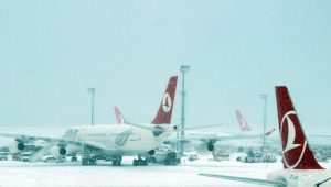 ISTANBUL, TURKEY - JANUARY 07: Airliners are seen at the the snow covered apron of Ataturk International Airport during the heavy snowfall in Istanbul, Turkey on January 07, 2017. Due to the heavy snowfall, preventing landing at Ataturk International Airport, Airliners are diverted to Sabiha Gokcen International Airport. Several flights has been canceled due to bad weather conditions. Izzet Taskiran / Anadolu Agency
