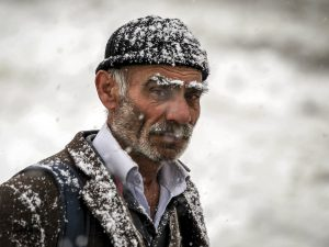 HAKKARI, TURKEY - DECEMBER 01: An old man is seen as heavy snowfall influence living negatively in Hakkari, Turkey on December 01, 2016. There is no transportation to 9 villages and 22 towns due to heavy snowfall. Yilmaz Kazandioglu / Anadolu Agency