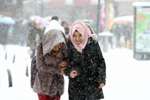 MALATYA, TURKEY - DECEMBER 14: People walks on the snowy road as heavy snowfall hits Malatya province of Turkey on December 14, 2016. Emrah Gokmen / Anadolu Agency