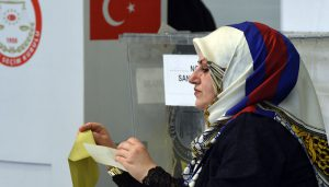 A polling clerk is working at a polling station in Munich, southern Germany, on March 27, 2017.  Turkish expatriates in Germany and five other European countries started casting their ballots Monday in a controversial referendum that could vastly boost President Recep Tayyip Erdogan's powers. / AFP PHOTO / Christof STACHE