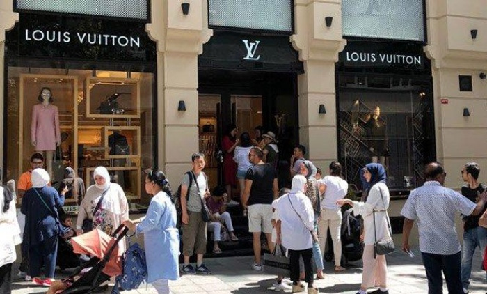 Tourists flocking to malls before international brands raise